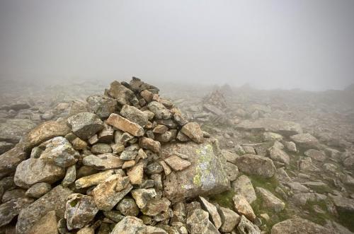 Cairns mark the way through the mist